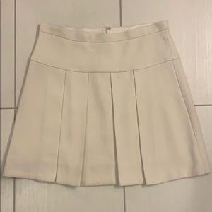 JCrew cream pleated skirt